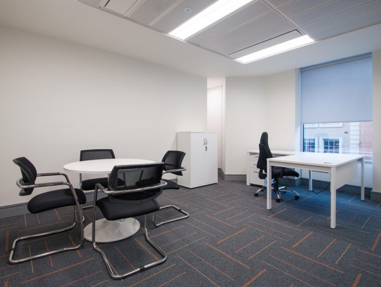 Apex Office Layout White Radial Desk with White Storage and Round Coffee Table with Black Office Chairs