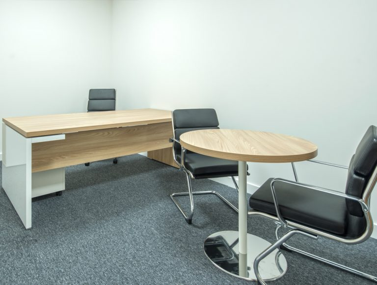 Office fit-out in Dublin with executive desk and black chairs