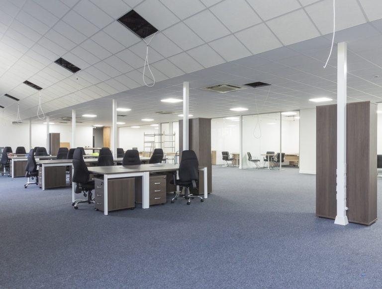Moduslink office fit-out open floor view with desks and chairs