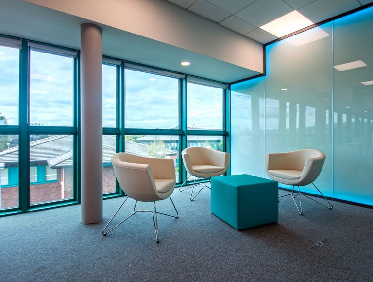 Breakout area for meetings in office dublin. Cream tulip chairs