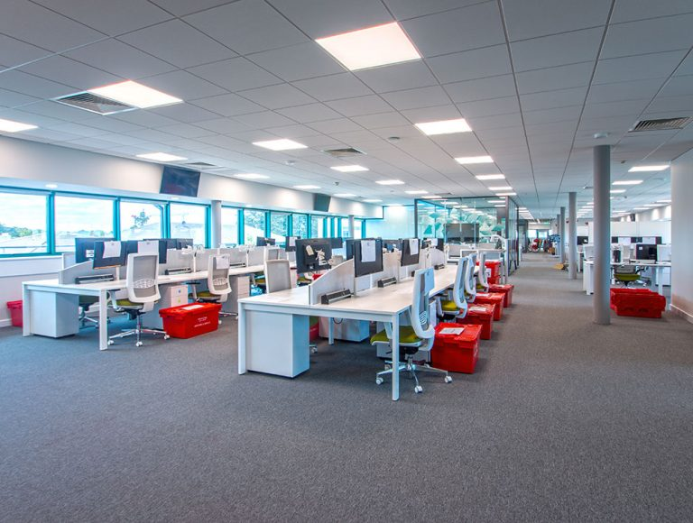 Office refurbishment in open floor area with white desks workstation and chairs