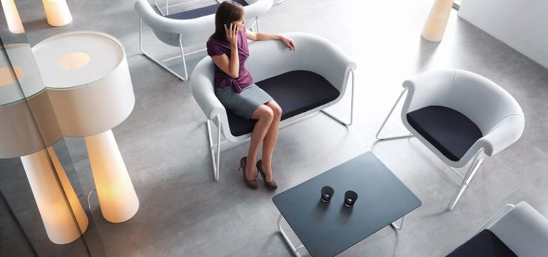 soft-seating-office-furniture-in-black-and-white-colour-with-white-metal-footing