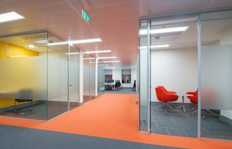 Apex-Office-Layout-Orange-Tub-Meeting-Chairs-with-Glass-Coffee-Table-in-Swivel-Base