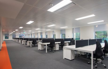 Apex-Office-Layout-White-Back-to-Back-Desks-along-with-Pedestals-and-Blue-Desk-Screens-and-Office-Chairs