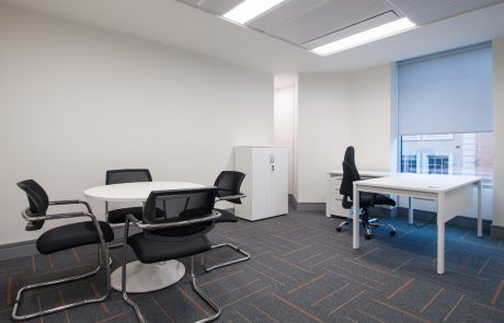 Apex-Office-Layout-White-Radial-Desk-with-White-Storage-and-Round-Coffee-Table-with-Black-Office-Chairs